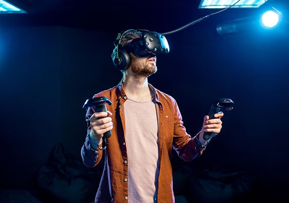 A picture of a gamer playing with a VR headset.