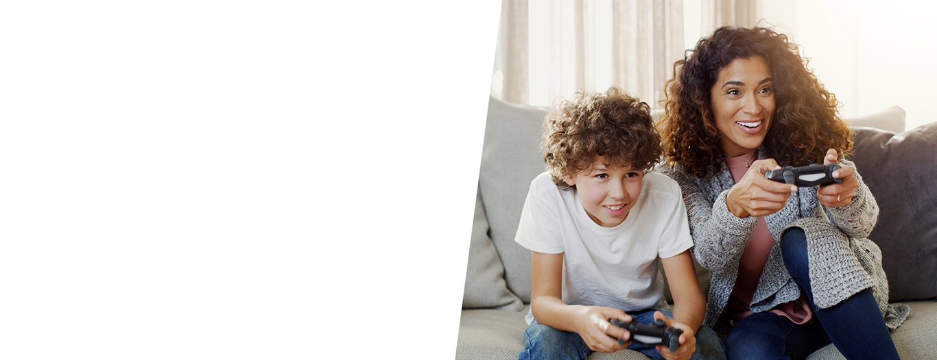 A picture of a mom and her son playing play station four.