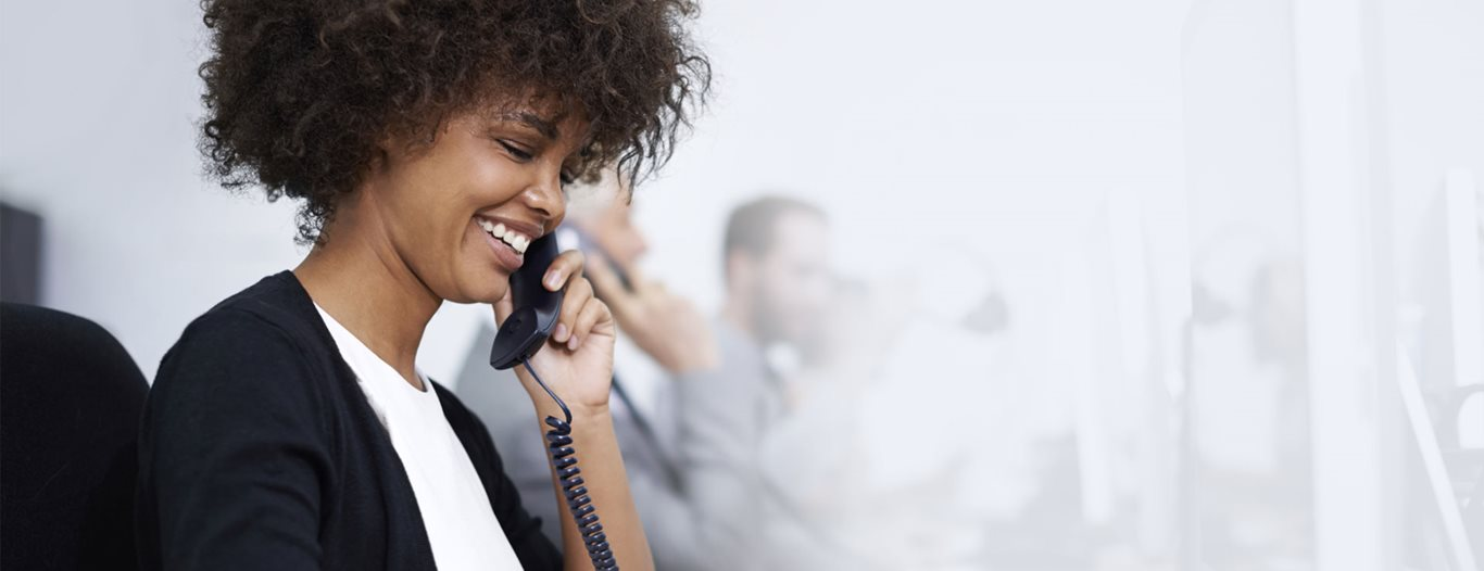 Woman on the phone in a call center